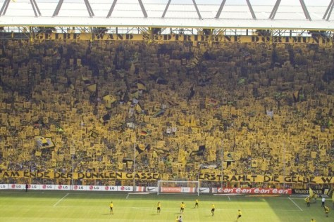 "the southern terrace of the stadium is Dortmund's ""Yellow Wall,"" which the largest free-standing grandstand in Europe with a capacity of 25,000."