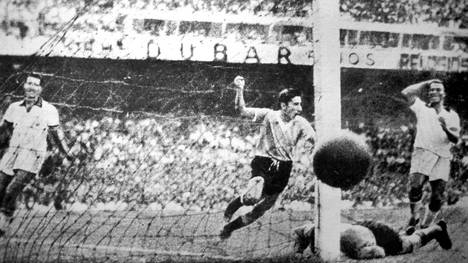 Alcides Ghiggia scores for Uruguay against Brazil at the Maracana in the final match of the 1950 FIFA World Cup